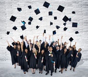 Group of Graduating Students Celebrating Stock Images