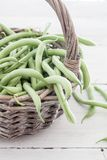 Green beans. Group of green beans on white table royalty free stock photos