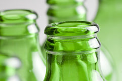 A group of Green beer bottles. Abstract of a group of Green beer bottles Royalty Free Stock Photo