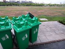 Group of green bins for general waste in plaza Stock Photography