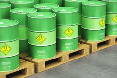Group of green biofuel drums on shipping pallets in the storage. Creative abstract ecology, alternative sustainable energy and environment protection saving Stock Image