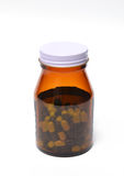 Group of green capsule medicine in bottle Royalty Free Stock Image