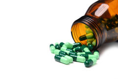 Group of green capsule medicine in bottle Stock Photos