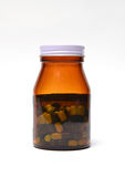 Group of green capsule medicine in bottle Stock Image