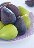 Group of green figs and blacks on a plate Stock Photo