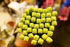 Group of green plastic chopsticks close up in Hand holding royalty free stock photo