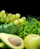 Group of green vegetables and fruits on black Royalty Free Stock Images