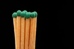 Group of green wooden matches on black background. Group of green wooden matches isolated on black background Royalty Free Stock Photo