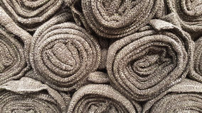 Group of grey fabric roll selection / stock of grey fabric for fashion design business. Raw material in garment manufacturing royalty free stock photography
