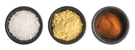 Group of Ground Red Pepper, Salt and Mustard Powder Isolated Royalty Free Stock Image