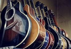 Group of guitars in exposition Royalty Free Stock Photo
