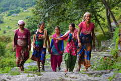 Group of Gurung women in traditional costumes. Himalaya, Nepal. GHANDRUK, NEPAL, OCT 6, A group of Gurung women in traditional costumes going to work in the stock photos