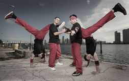 Group of guys performing acrobatic stunts Royalty Free Stock Photography