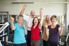 Group in gym cheering. Happy elderly group in a gym cheering stock photography