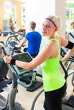 Group in gym on elliptical trainer Royalty Free Stock Photos