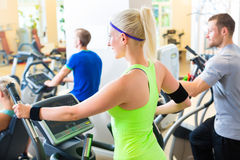 Group in gym on elliptical trainer Royalty Free Stock Image