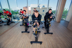 Group of gym people on machines, cycling In Class Royalty Free Stock Photography