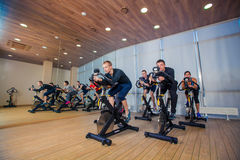Group of gym people on machines, cycling In Class Royalty Free Stock Photos