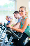 Group in gym spinning on sport bicycle Royalty Free Stock Photo