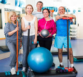 Group in  gym with sport equipment Stock Image