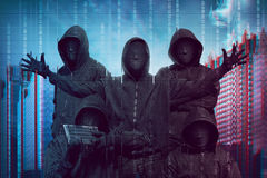 Group of hacker with anonymous mask. Against binary code in background stock photography