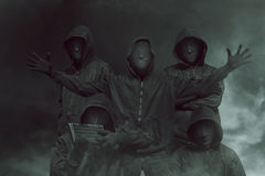 Group of hacker with mask in hoodies Stock Images