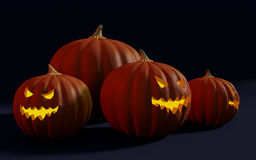 Group of Halloween jack-o-lanterns and a giant pumpkin Stock Images
