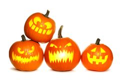 Group of Halloween Jack o Lanterns isolated on white Stock Photography