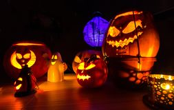 Group of halloween pumpkins on the dark background, dark scenery Stock Image