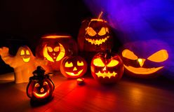 Group halloween pumpkins and the violet smoke Stock Photography