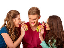 Group hamburger fast food with ham in people hands . Stock Photography