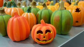 Group of hand painted colorful decoration clay pumpkins for Halloween royalty free stock image