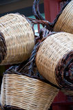 Group of handmade baskets straw attached to the door Royalty Free Stock Images