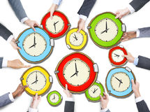 Group of Hands Holding Clock Royalty Free Stock Images