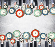 Group of Hands Holding Clock. S Royalty Free Stock Photos