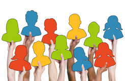 Group of Hands Holding Colorful Characters Stock Photography