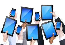 Group of Hands Holding Communication Devices Royalty Free Stock Images