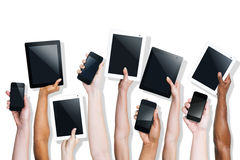 Group of Hands Holding Digital Devices Royalty Free Stock Image