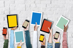 Group of Hands Holding Digital Devices Stock Images