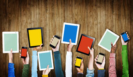 Group of Hands Holding Digital Devices with Copy Space Royalty Free Stock Images