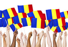 Group of Hands Holding Flag of Romania Stock Photo