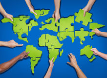 Group of Hands Holding and Forming World Puzzle Royalty Free Stock Photos
