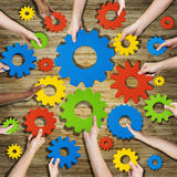 Group of Hands Holding Gears Symbol Royalty Free Stock Images