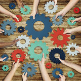 Group of Hands Holding Gears Symbol Stock Image