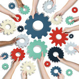 Group of Hands Holding Gears Symbol Stock Photos