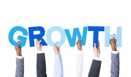 Group of Hands Holding Growth stock photos
