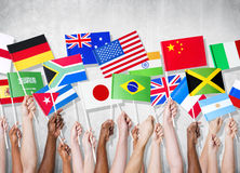 Group Of Hands Holding National Flags.  Royalty Free Stock Photo