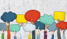 Group of Hands Holding Speech Bubbles Stock Photography