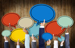 Group of Hands Holding Speech Bubbles Royalty Free Stock Photography