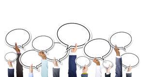 Group of Hands Holding Speech Bubbles Royalty Free Stock Images